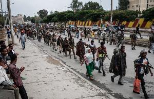 Pro-TPLF rebels walk in lines towards a field in Mekelle, the capital of Tigray region, Ethiopia