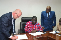 Stakeholders involved signing the documents