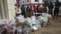 The alleged suspects with the illegal products confiscated