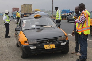 MTTD officers checking the licence of a driver (file photo)