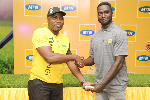 Daniel Asare Senior Manager Enterprise Business of MTN to winner of Men's group A Samuel Gyekye