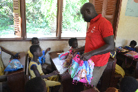 Airtel Employee distributing the gift packs to the pupils