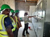 Madam Annelies De Beule,  pointing to the project plan as the Ministers  look on