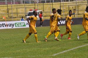 AshantiGold players celebrate victory