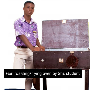 Emmanuel Nimo with his invention
