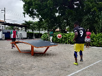 Teqball players, Samuel Aidoo and Akoto demonstrating the rules of the game to the gathering