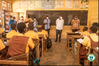 Mohammed Adjei Sowah, Chief Executive of Accra Metropolitan,(in white) interacting with the pupils