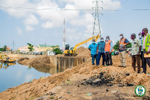 AMA Mayor, Mohammed Adjei Sowah inspecting a dredging exercise in the Odaw drain