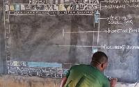 Owura Kwadwo teaching ICT