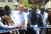 The Director of crops at Mofa, Mr Seth Osei-Akoto (right), cutting the tape for the relaunch