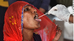 Health worker collects a swab sample for a Covid-19 test in Mumbai, India