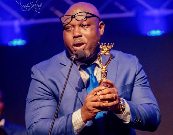 An official of Praise TV giving acceptance speech after winning the award