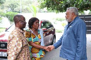 Former President Rawlings presenting the car to Madam Pomary