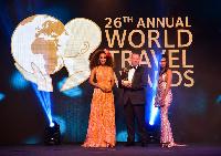 General Manager of Kwarleyz Residence Accra receiving the award