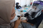 COVID is surging through Indonesia where only about 8 percent of the population is fully vaccinated