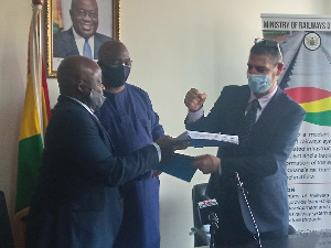 Joe Ghartey (middle), Richard Diegong Dombo (left) and Mr Nadav Simhoni (right) exchanging contract
