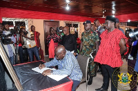 President Akufo-Addo signing the book of condolence in honour of Togbe-Gabusu