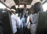 A young man preaching in a trotro