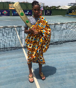 Akua Hansen with the trophy she won