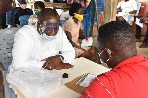 Member of Parliament for Ellembelle, Emmanuel Armah Kofi-Buah going through the registration process