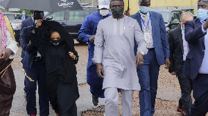 Senegalese-American performer Akon, right and his wife Rozina, arrive in Uganda