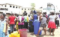 A water tanker distributing water