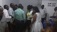 Sherry Ayittey (middle) intercating with some party members after a meeting