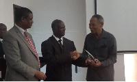 Professor Francis K. Nkrumah receiving his award from Dr. Ebenezer Appiah Denkyirah of the GHS