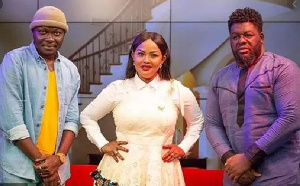 Arnold Asamoah-Baidoo (L), Nana Ama McBrown and Bulldog pose for a photo after the show