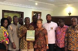 Dr. Owusu Afriyie Akoto displaying his award