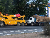 The loaded truck being towed
