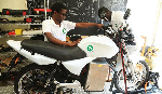 Technicians test one of the e-motobikes at Ampersand Rwanda's workshop at Kimihurura in Kigali