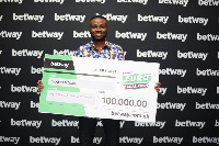 Adomako Baafi with his dummy cheque