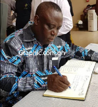 Rev Prof Frimpong Manso, General Superintendent of Assemblies of God signs the book of condolences