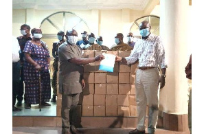 Chief Togbe Afede making the donation