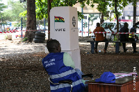An officer sits  idle as voters did not turn up to cast their vote