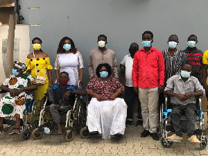 Otiko Afisa Djaba pictured with some persons with disabilities