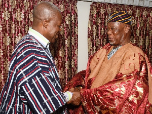 Buipewura Abdulai Jinapor II congratulating the Vice President after decorating him with a smock