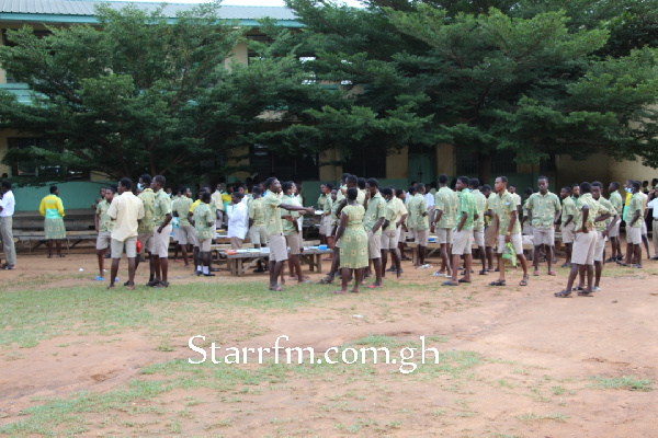 Oti Boateng SHS students compete with birds for space as they dine under trees