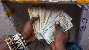Black market trader wey dey count dollars