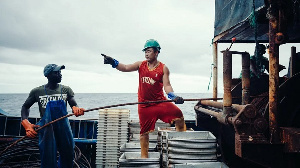 File photo of a Chinese and local crew member on a fishing boat