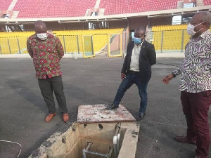 The minister with some members from MoYS at the stadium