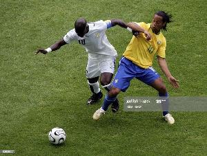 Stephen Appiah and Ronaldinho of Brazil
