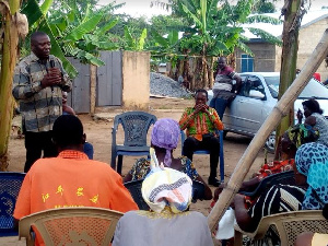 Fredrick Opare Ansah interacting with some members of his Constituency