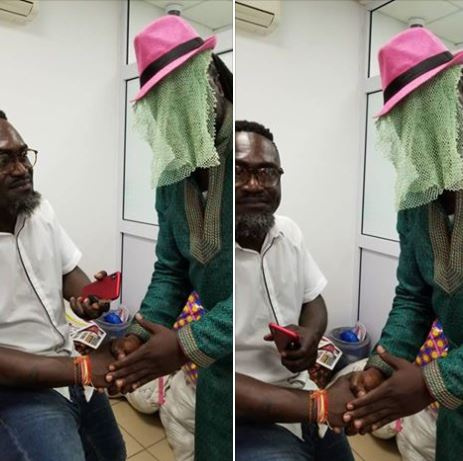 Countryman Songo receiving a handshake from 'Anas'
