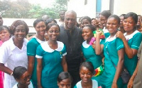 Former President John Dramani Mahama with some nurses