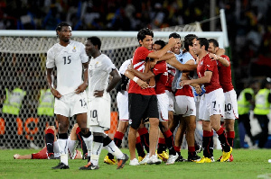 The Black Stars in disappointment as the Egyptians jubilate