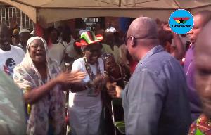 Former President John Mahama interacting with some jubilant women at Winneba