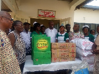 Amissa-Arthur( M) and wife Matilda (second from L) donated items to the hospital