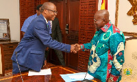 President Akufo-Addo (R) charged Dr Addison to help ensure economic growth